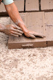Worker making handmade bricks Stock Image