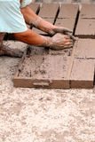 Hands of worker making bricks Stock Images