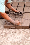 Hands of worker making bricks Royalty Free Stock Images