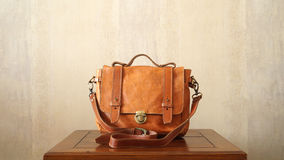 Hand Made Brown Vintage leather briefcase On Table Stock Photo