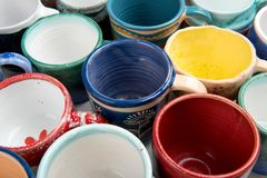 Hand-made ceramic cups in multicolor glaze Stock Photography