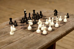 Hand-made chessboard. On wooden table, selective focus Stock Photo