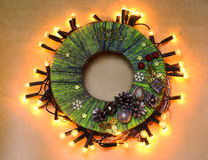 Hand made child craft Traditional New Year`s door wreath from thread. Child craft background. Traditional New Year`s door wreath components: Christmas cones Stock Photos