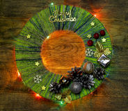 Hand made child craft Traditional New Year`s door wreath from thread. Child craft lamp nightlight. Traditional New Year`s door wreath components: Christmas cones Stock Photo