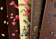 Hand-made chocolate bars (with candied petals). Hand-made bars of chocolate mixed with candied petals Royalty Free Stock Images