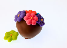 Hand made Chocolate. Luxury hand-made milk chocolate covered truffle decorated with flowers Stock Photography