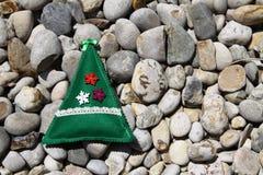 Hand made christmas decor on pebble stones Stock Image