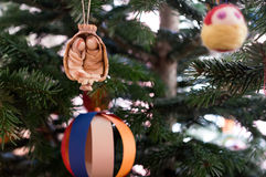 Hand made Christmas decoration hanging in the tree Stock Photography