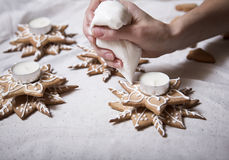 Hand made christmas ornament, candy candle holder. Woman's hand decorates seasonal decorative items Royalty Free Stock Image