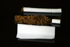 Hand made cigarette. Using tobacco filter and rolling paper stock image