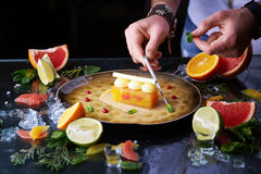 Hand made citrus tart with chef's hand Royalty Free Stock Photography