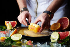 Hand made citrus tart with chef's hand Royalty Free Stock Image