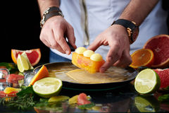 Hand made citrus tart with chef's hand Stock Photo
