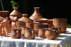 Hand made clay pots. Stands on a table royalty free stock image