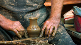 Hand made clay vase. Clay potter hands wheel pottery work workshop man Royalty Free Stock Photos