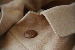 Design and sewing details. Hand made coat in macro Stock Image