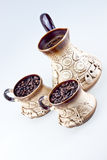 Hand made Coffee set. (coffee pot & cups) with a black coffee & coffee beans inside royalty free stock photography