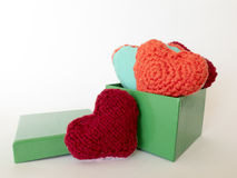 Hand made of colorful hearts made of wool and fabric Royalty Free Stock Photos