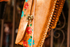 Hand made colorful leather little bags in Mexican market. Hand made leather small bags in Mexican market Royalty Free Stock Photos