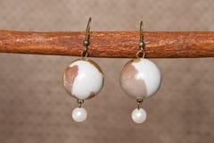 Hand-made coloured earrings Stock Photos