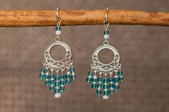 Hand-made coloured earrings Royalty Free Stock Photos