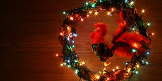 Hand made craft roosters decorations. Happy New Year and Merry Christmas holiday template card.
