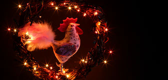 Hand made craft roosters decorations. Happy New Year and Merry Christmas holiday template card. Stock Image