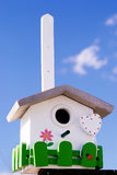 Hand made creative nestling box. On sky blue background royalty free stock images