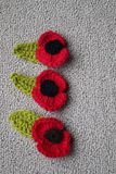 Hand made crochet poppy for Remembrance Day. Remembrance Day Poppy's made with wool by royalty free stock images