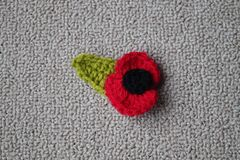 Hand made crochet poppy for Remembrance Day. Remembrance Day Poppy's made with wool by stock photo