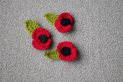 Hand made crochet poppy for Remembrance Day. Remembrance Day Poppy's made with wool by stock image