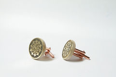 Hand made cuff links with brass etching Royalty Free Stock Photos