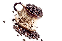 A hand made cup with coffee beans Royalty Free Stock Photography