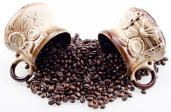 Hand made cups spill the coffee beans Stock Images