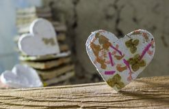 White hearts. Hand-made decorative hearts made of recycled paper royalty free stock photography