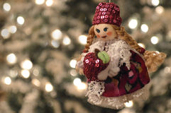 Hand made doll. Hand made Christmas ornament - doll holding an apple Stock Photography