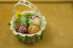 Hand made Easter basket on a wooden table royalty free stock photography