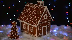 The hand-made eatable gingerbread house, New Year tree, snow decoration stock video footage