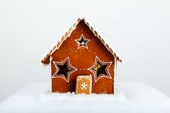 The hand-made eatable gingerbread house. And snow decoration stock images
