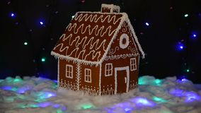 The hand-made eatable gingerbread house, snow decoration stock footage