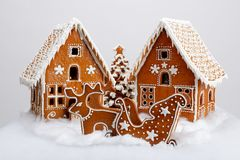 The hand-made eatable gingerbread houses, reindeer and cart stock images