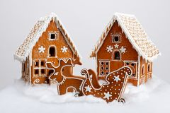 The hand-made eatable gingerbread houses, reindeer and cart royalty free stock photo