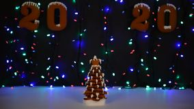 The hand-made eatable gingerbread New Year tree, 2020 inscription, snow decoration stock video footage