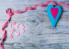 Hand made felt colorful hearts on wooden background. Concept for congratulation, inviting, wedding banner, flyer. Craft element for Valentine`s Day, romantic Royalty Free Stock Photos
