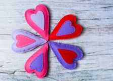 Hand made felt colorful hearts on wooden background. Concept for congratulation, inviting, wedding banner, flyer. Craft element for Valentine`s Day, romantic Royalty Free Stock Photo