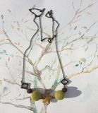Felt wool Necklace. Hand Made from Felt Wool Felt Necklace with volcanic rock on a hand painted watercolour background Stock Photography