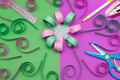 Hand made flower with ruler pen scissors and stapler Royalty Free Stock Photo