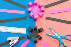 Hand made flower with ruler pen scissors and stapler Stock Photography