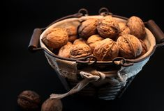 Hand made, full with nuts iron basket stock image