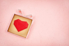 Hand made gift box with heart inside Stock Photography